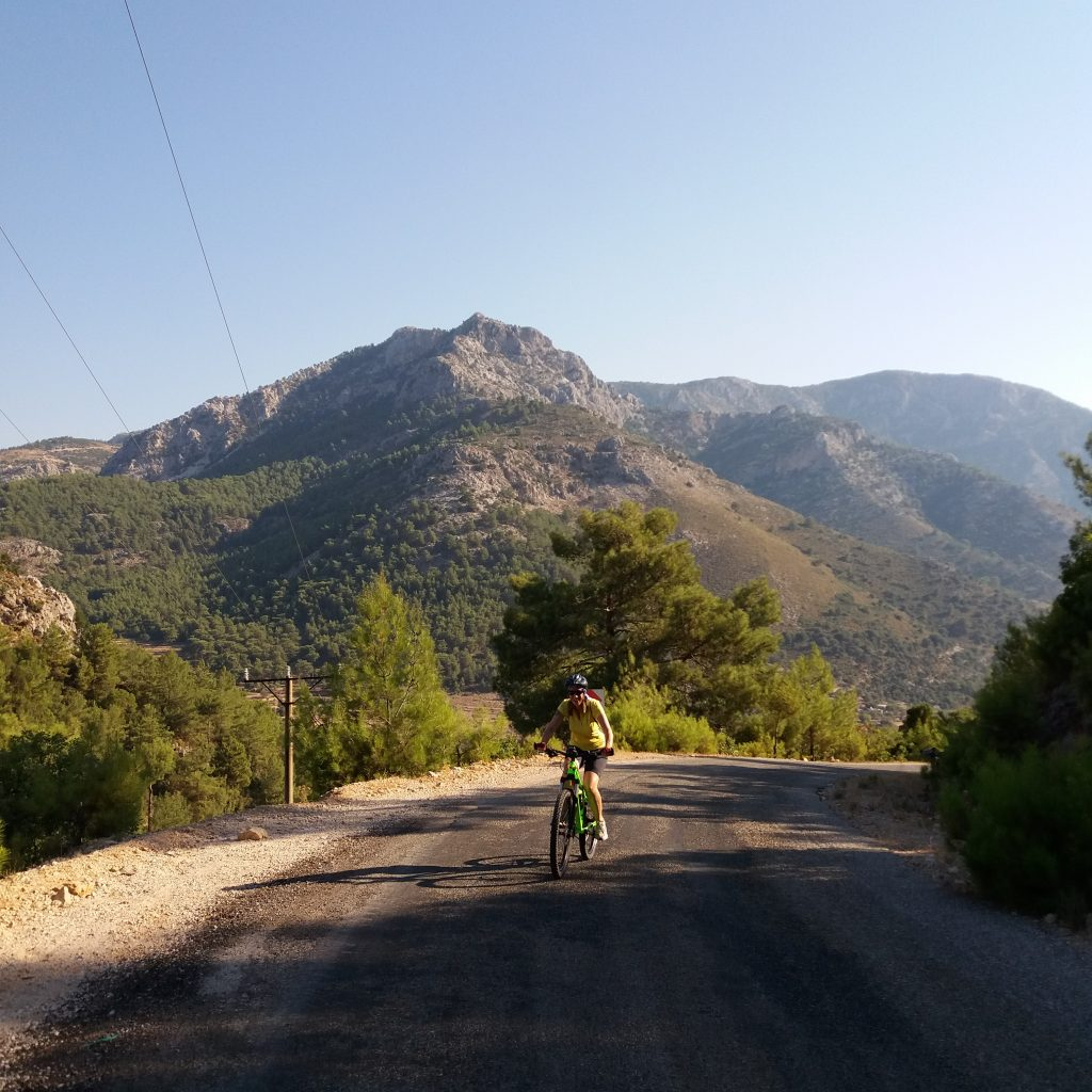 Mountain biker on quiet road Fethiye